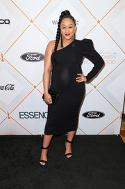 Tia Mowry complemented her dress with black ankle-strap sandals.