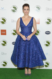 Bellamy Young paired her dress with sparkly blue pumps by Alexander White.