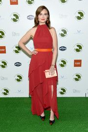 Emily Deschanel styled her dress with a pair of colorful pumps.