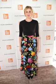 Greta Gerwig dressed up her plain top with a colorful floral maxi skirt by Gucci.
