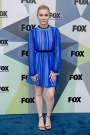 Skyler Samuels brought a gorgeous pop of color to the 2018 Fox Network Upfront with this electric-blue cocktail dress by MSGM.