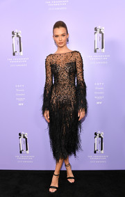 Josephine Skriver was sultry and sophisticated in a sheer feathered dress by Zuhair Murad Couture at the 2018 Fragrance Foundation Awards.
