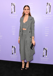 Olivia Palermo rounded out her look with a pair of black cross-strap sandals by Christian Louboutin.