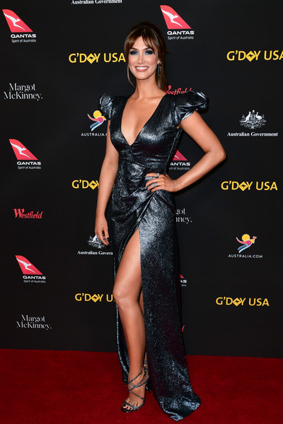 Delta Goodrem flashed some skin in a high-slit, deep-V metallic gown at the 2018 G'Day USA Black Tie Gala.