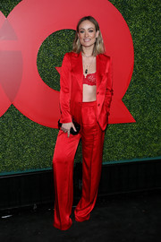 Olivia Wilde looked sizzling-hot in a scarlet Selmacilek pantsuit teamed with a lace bra at the 2018 GQ Men of the Year party.