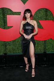 Charli XCX showed plenty of skin in a high-slit leather dress at the 2018 GQ Men of the Year party.