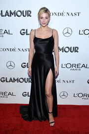 Lili Reinhart complemented her dress with black ankle-strap sandals.