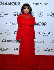 Kat Graham kept it modest in a tiered red gown by Christian Siriano at the 2018 Glamour Women of the Year Awards.