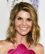 Lori Loughlin wore her hair in edgy-glam waves at the 2018 Hallmark Channel Summer TCA event.