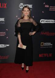 Emily Deschanel made an elegant choice with this black sheer-panel gown for the 2018 IDA Documentary Awards.