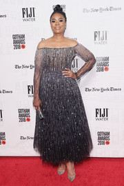 Regina Hall added more glitter with a pair of beaded nude pumps by Christian Louboutin.