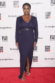 Uzo Aduba styled her dress with silver ankle-strap sandals by Casadei.
