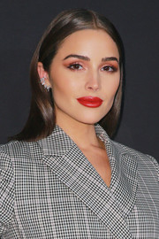 For her beauty look, Olivia Culpo teamed sexy red lipstick with pink eyeshadow.