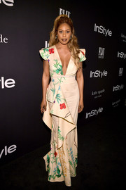 Laverne Cox went ultra feminine in a ruffled floral gown by Johanna Ortiz at the 2018 InStyle Awards.