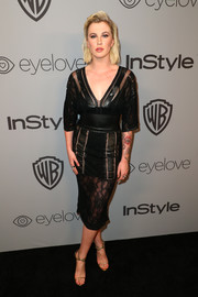 Ireland Baldwin styled her dress with strappy gold heels.