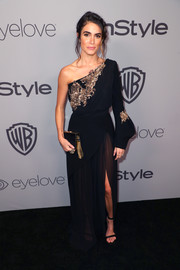 Nikki Reed paired her dress with simple ankle-strap heels by Sophia Webster.