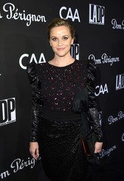 Reese Witherspoon paired a black Christian Louboutin velvet clutch with an embellished LBD for the L.A. Dance Project Gala.