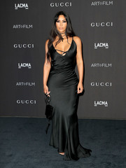 Kim Kardashian looked sultry, as always, in a vintage Gucci by Tom Ford slip gown at the 2018 LACMA Art + Film Gala.