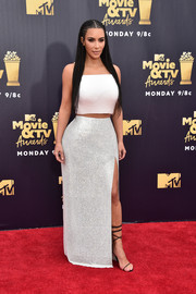 Kim Kardashian teamed her top with a shimmering maxi skirt, also by Atelier Versace.