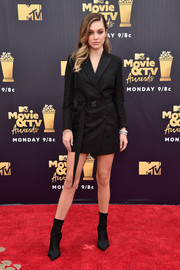 Delilah Belle Hamlin looked cool and edgy in a belted black tux dress at the 2018 MTV Movie & TV Awards.