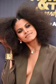 Zazie Beetz glammed up her look with a chic gold cuff.