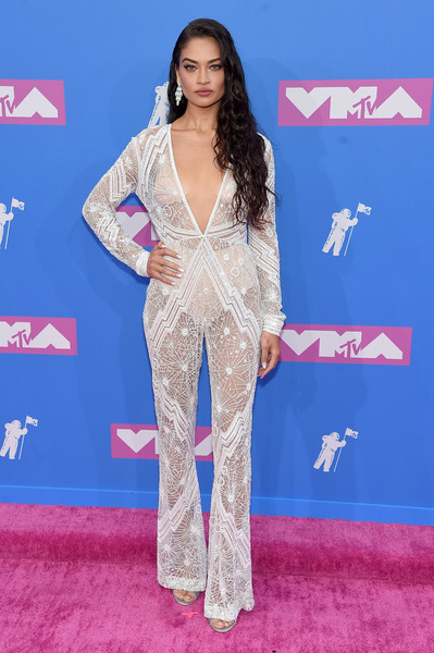 Shanina Shaik went racy in a sheer, plunging white jumpsuit by Naeem Khan at the 2018 MTV VMAs.