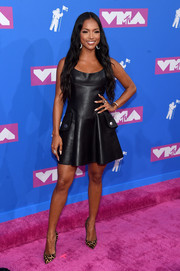 Karrueche Tran opted for a little black leather dress when she attended the 2018 MTV VMAs.