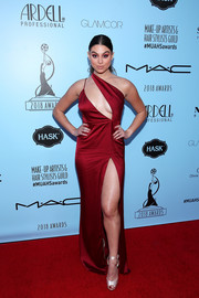 Kira Kosarin vamped it up in a cleavage-and-leg-flaunting red one-shoulder gown by Meshki at the Make-Up Artists & Hair Stylists Guild Awards.