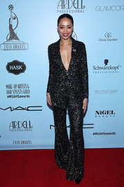 Amber Stevens West got all sparkled up in a black sequin pantsuit by Thai Nguyen Atelier for the 2018 Make-Up Artists & Hair Stylists Guild Awards.