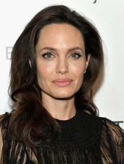 Angelina Jolie played down her pout with a soft pink hue.