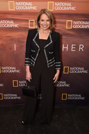 Katie Couric layered a cropped tweed jacket over a jumpsuit for the 2018 National Geographic Upfront.