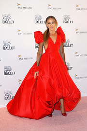 Sarah Jessica Parker completed her head-turning look with a pair of metallic red pumps from her label.