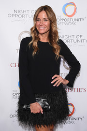 Kelly Bensimon teamed a black crocodile clutch with a flirty LBD for the 2018 Night of Opportunity Gala.