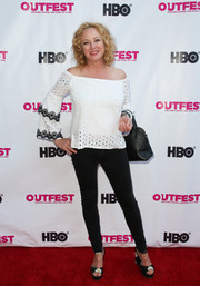 Virginia Madsen teamed her blouse with black skinny jeans.