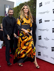 Heidi Klum looked vibrant in a vintage Valentino print gown at the 2018 From Paris with Love Gala.