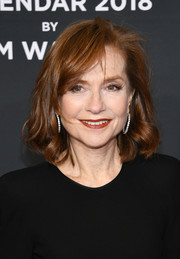 Isabelle Huppert attended the 2018 Pirelli Calendar launch wearing her hair in a textured bob.