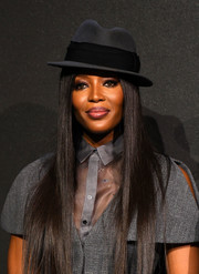 Naomi Campbell spiced up her look with a gray and black fedora by Christian Dior for the 2018 Pirelli Calendar press conference.