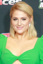 Meghan Trainor styled her hair into a mildly messy half-up 'do for the 2018 Radio Disney Music Awards.