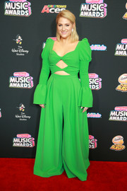 Meghan Trainor turned heads in a kelly-green cutout jumpsuit by Christian Siriano at the 2018 Radio Disney Music Awards.