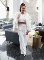 La La Anthony topped off her monochromatic look with a stylish fur jacket.