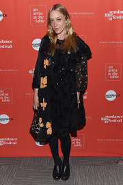 Chloe Sevigny attended the 2018 Sundance Film Festival Artist at the Table reception wearing a long-sleeve, mixed-material shift dress.