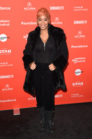 Anika Noni Rose added a luxurious touch with a black fur coat.