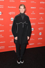 Mia Wasikowska covered up in a loose black pantsuit with white piping for the Sundance premiere of 'Piercing.'