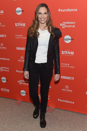 Hilary Swank kept warm in edgy style with a black leather jacket.