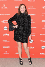 Molly Shannon complemented her dress with black gladiator heels.
