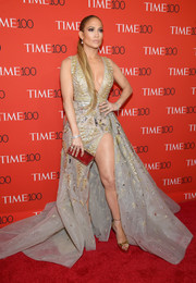 Jennifer Lopez complemented her dress with a pair of gold Jimmy Choo platforms.