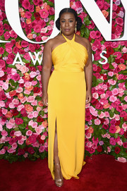 Uzo Aduba styled her dress with gold sandals by Jimmy Choo.