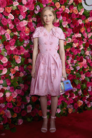 Tavi Gevinson finished off her ensemble with an iridescent purse.