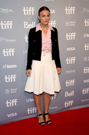 Black Jimmy Choo sandals with bedazzled buckles finished off Keira Knightley's ensemble.