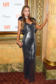 Paris Hilton looked totally red carpet-ready in a silver sequined gown at the TIFF premiere of 'The Death and Life of John F. Donovan.'